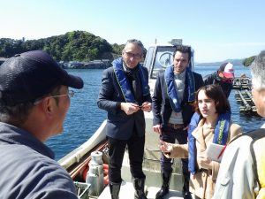 Alice interpreting during a courtesy visit by French oyster farmers to Kurimihama.
