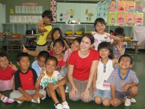 Amy with 1st -3rd grade students at Sesoko Elementary School in Okinawa, 2008