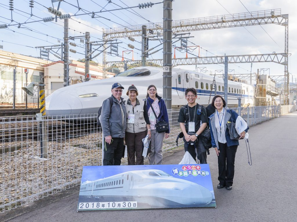 We experienced amazing hospitality from JR West at their Shinkansen Railyard in Hakataminami. A shinkansen has just had a train wash behind us.