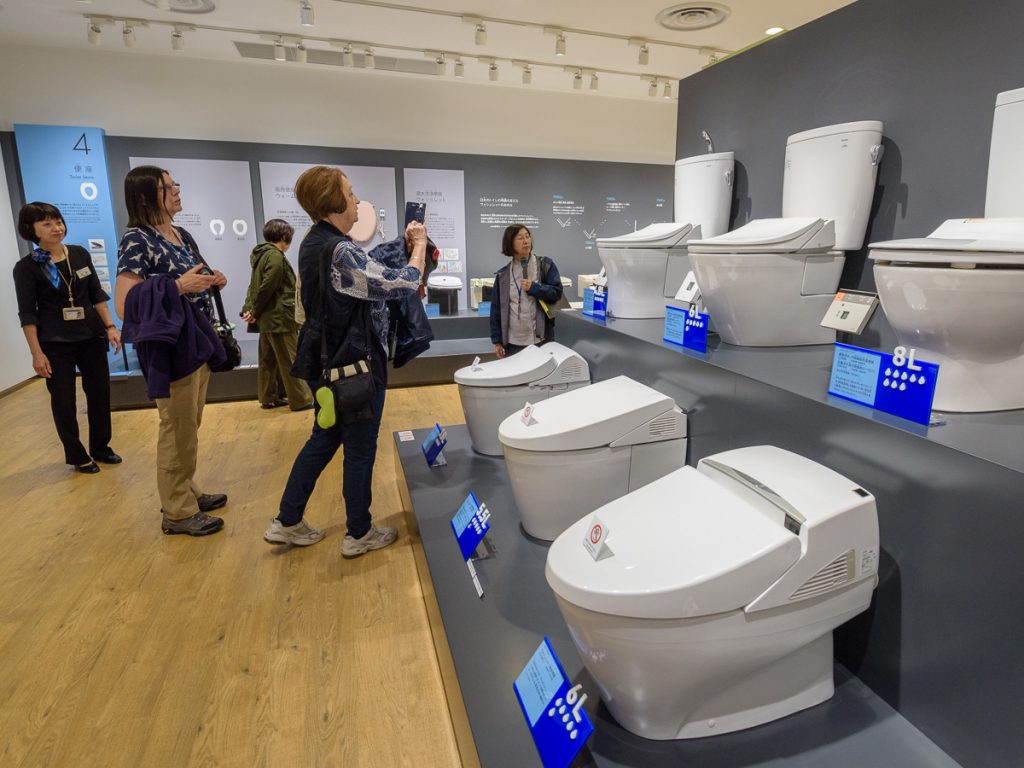 Tour members learnt about the water saving technology in TOTO's latest hi-tech toilets at the TOTO Museum in Kitakyushu.